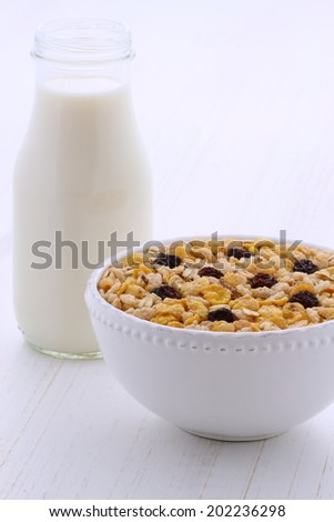 Delicious and nutritious muesli or granola cereal, on vintage appetizing french retro styling. - stock photo