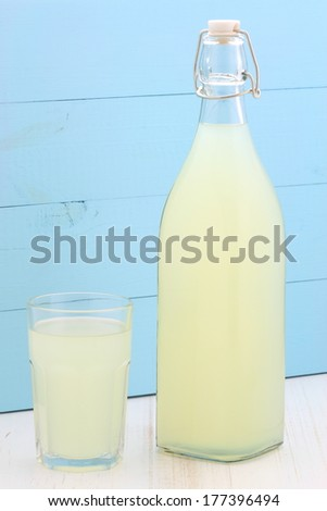 delicious and nutritious, organic lemonade on vintage bottle and glass - stock photo