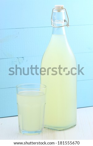 delicious and nutritious, organic lemonade on vintage bottle and glass