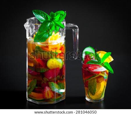 delicious and tasty alcohol cocktail Pimms beautiful black background bar concept fruit salad strawberries amazing
