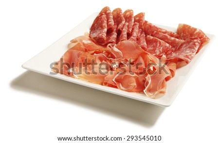 Delicious and tasty meat dishes. Ham, salam. Italian appetizers. - stock photo