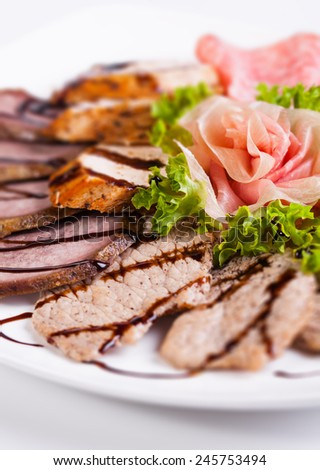 Delicious and tasty meat dishes on a white background. - stock photo