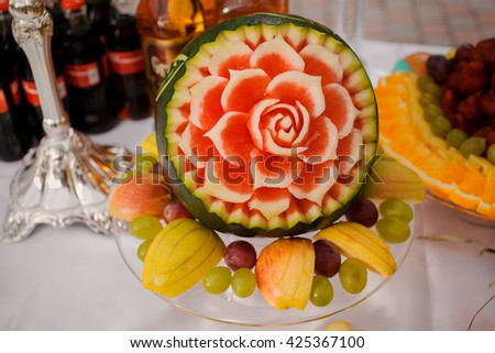 delicious and very healthy food at the wedding reception beautifully arranged on the tables - stock photo