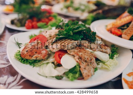 delicious and very healthy food at the wedding reception beautifully arranged on the tables