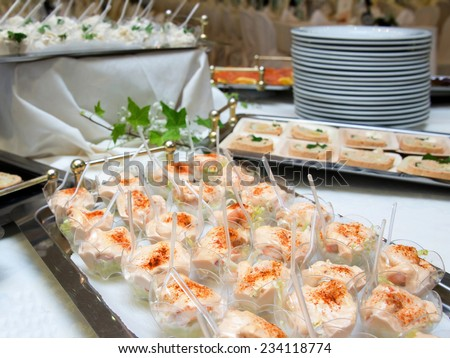 Delicious appetizer canapes in a wedding buffet. Selective Focus - stock photo