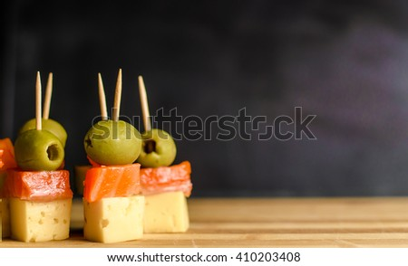 Delicious appetizers with cheese and mix ingredients - stock photo
