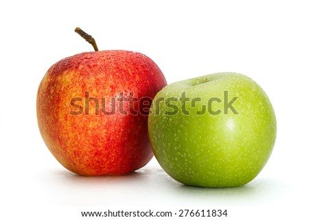 Delicious appetizing beautiful fresh green and red apples isolated on a white background. - stock photo