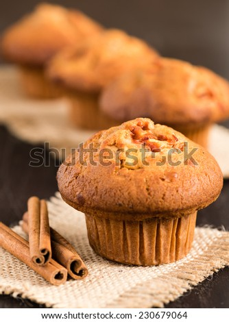 Delicious apple and cinnamon muffins - sweet food - stock photo