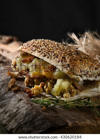 Delicious apple sauce, grilled pork and sage and onion stuffing filled Panini roll set against a rustic background with creative lighting. The perfect image for your bistro lunch menu. - stock photo