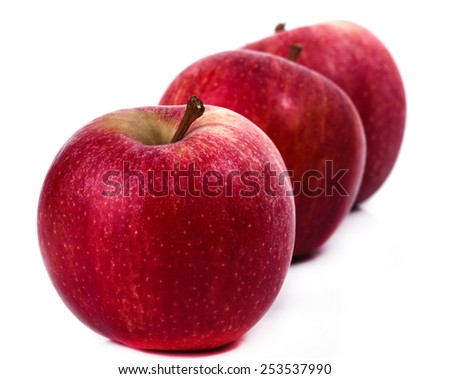Delicious apples on a white background - stock photo