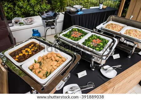 Delicious Asian cuisine buffet with seafood and vegetable dishes. - stock photo