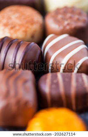 Delicious assortment of chocolates - stock photo