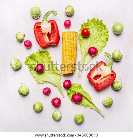 Delicious assortment of farm fresh vegetables  on wooden rustic background top view - stock photo