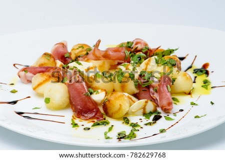 Delicious bacon salad with sauce in a white plate