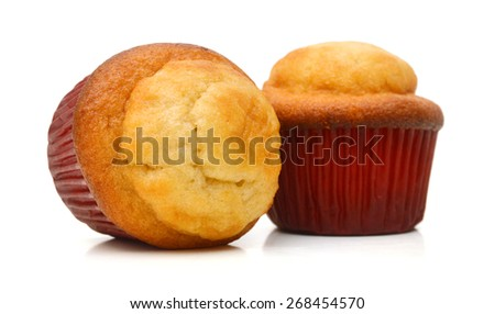 Delicious baked muffins on a white background - stock photo