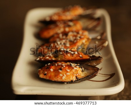 delicious baked mussles on white plate