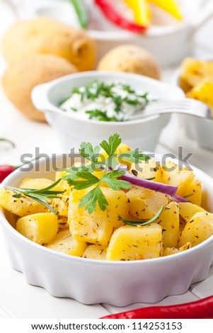 Delicious baked potatoes with sour cream