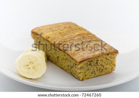 Delicious banana flavor cake topping with banana - stock photo