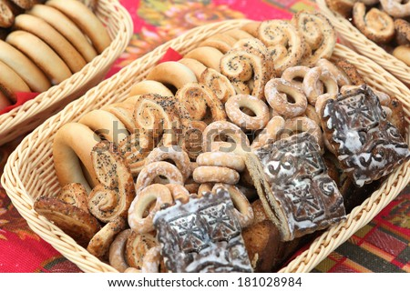 delicious barankas cookies and spice cakes on wicker dishes  beautiful food desing to kid party - stock photo