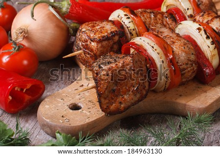delicious barbecue with vegetables on a chopping board. horizontal. close up  - stock photo