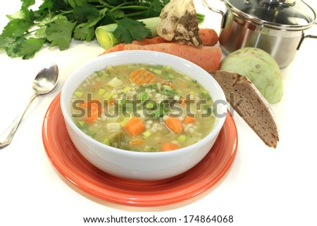 delicious Barley porridge with leeks on a light background