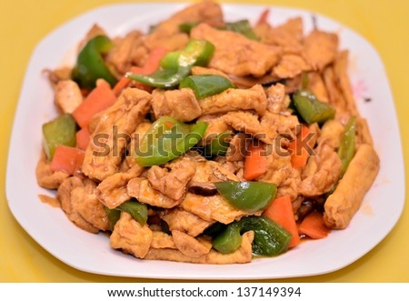 Delicious bean curd with green pepper dish - stock photo