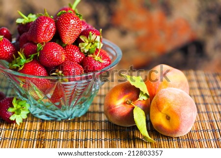 delicious beautiful  strawberries and peach background