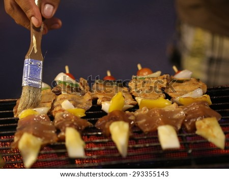 delicious beef bbq on grill ,Beef shish kebabs on skewers, cooking on the grill. Shallow depth of field.