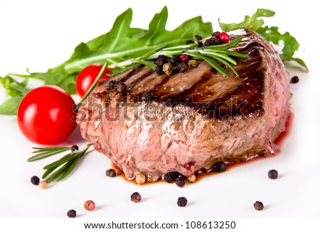 Delicious beef steak, medium grilled. Isolated on white background - stock photo