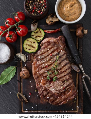 Delicious beef steak on black stone table, close-up. - stock photo