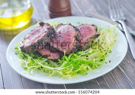 Delicious beef steak with salad