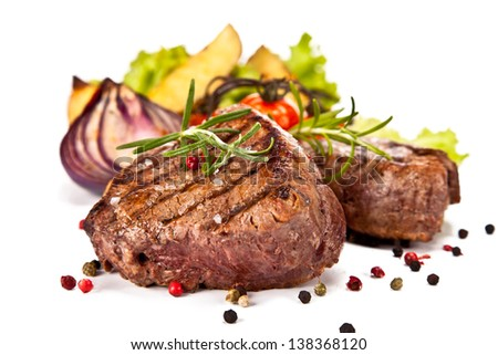 Delicious beef steaks isolated on white background - stock photo