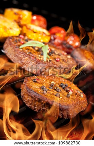 Delicious beef steaks on grill - stock photo