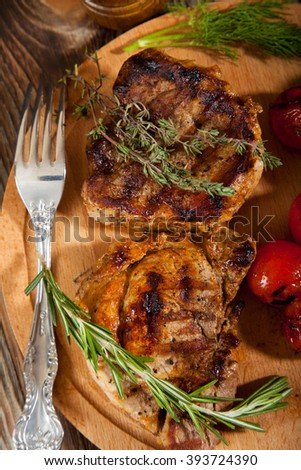 Delicious beef steaks on wooden table