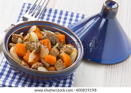 Delicious beef stew with pumpkin and onion in tajine pot/Stew meat with pumpkin in tajine  - stock photo
