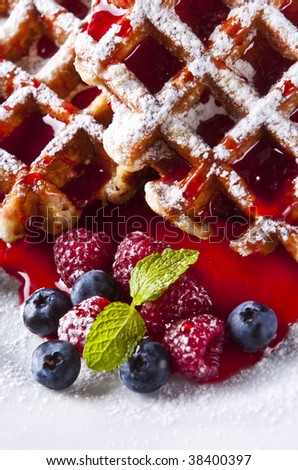Delicious Belgian waffles garnished with fresh raspberries