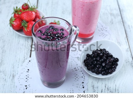 Delicious berry smoothie on table, close-up