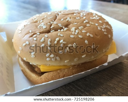 Delicious big chicken Hamburgers in white paper box on wooden table