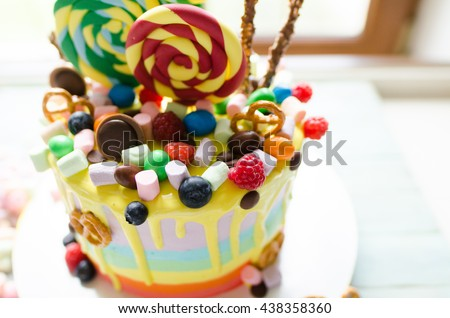 Delicious birthday cake  on table on light background. marshmallow