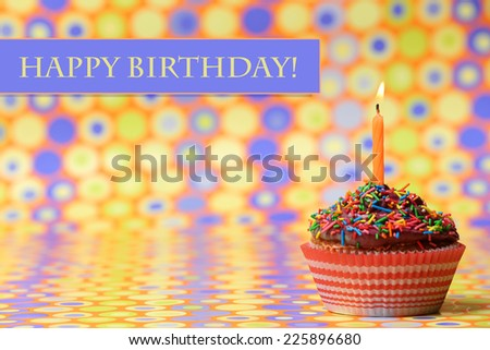Delicious birthday cupcake on bright background - stock photo