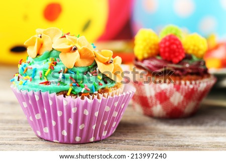 Delicious birthday cupcakes on table close-up