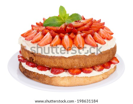 Delicious biscuit cake with strawberries isolated on white - stock photo