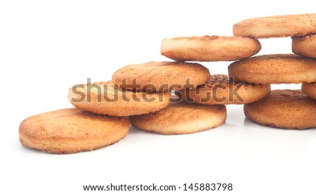 Delicious biscuits laid out stepwise on the white background