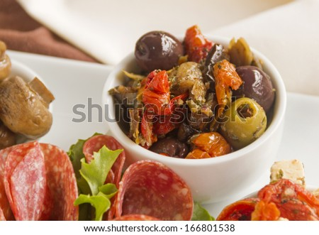 Delicious black olives and stuffed green olives with sundried tomato. - stock photo