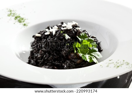 Delicious Black Risotto Bowl with Parsley - stock photo