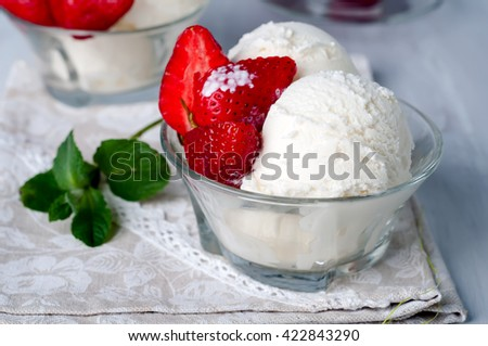 Delicious bowl of strawberry ice cream in table - stock photo