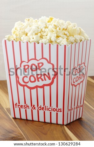 Delicious box of movie popcorn healthy and delicious snack for adults and kids alike. - stock photo