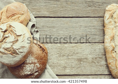 Delicious bread loaf on the table - stock photo