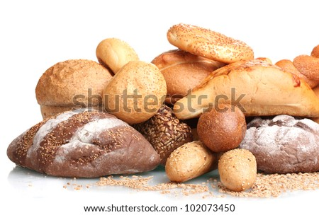 delicious breads and wheat isolated on white - stock photo