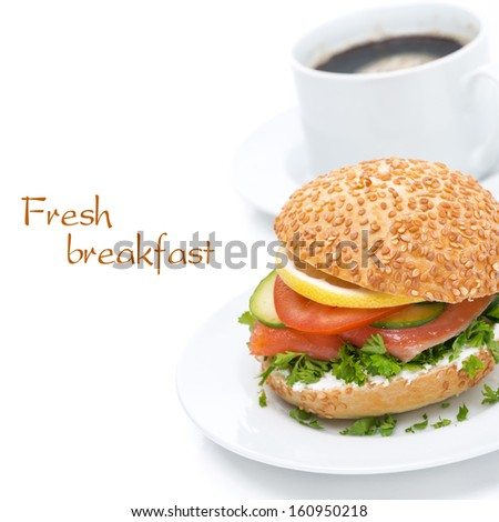 delicious breakfast - burger with smoked salmon, vegetables and coffee, isolated on white - stock photo
